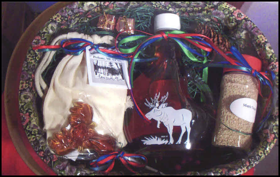 Oval-shaped gift basket containing organic Maine maple syrup and other maple products