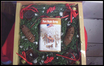 Square wooden gift basket containing Maine maple syrup and other maple products